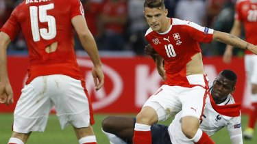 Not ideal: Granit Xhaka feels the breeze against France.