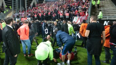 Medics tend to wounded Lille' supporters following the stadium collapse.