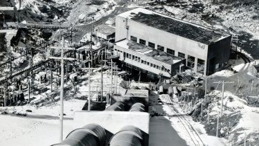 Guthega power station, the first of 17 power stations to be built in the Snowy Mountains. Down through these huge steel penstock pipes, water from the three and a quarter mile Guthega-Munyang tunnel rushes down to the turbines of the power station.