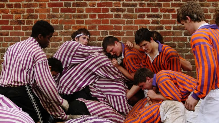 The Collegers and the Oppidians of Eton College take part in the Wall Game, one of the school's oldest traditions, in 2007.