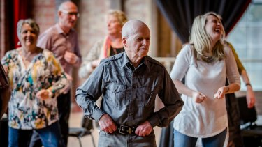 Mr Morrison joins a line dance in December.