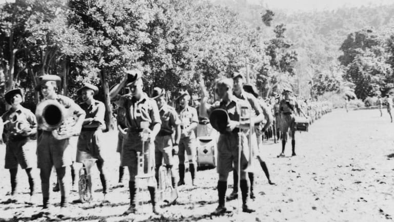 The band of 2/22 Battalion, with the battalion behind it. Some were among the 160 soldiers executed at Tol in 1942.