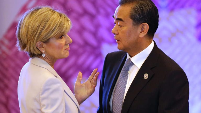 Chinese Foreign Minister Wang Yi, right, talks with his Australian counterpart Julie Bishop at the ASEAN forum in the Philippines.