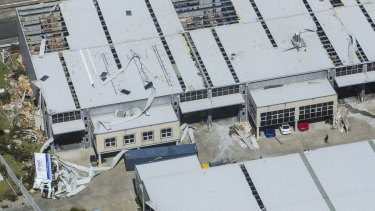 A truck lies on its side next to damaged buildings at the Kurnell plant.