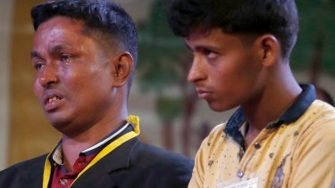 A Rohingya Muslim refugee, left, breaks down after meeting Pope Francis at an interfaith peace meeting in Dhaka, Bangladesh.