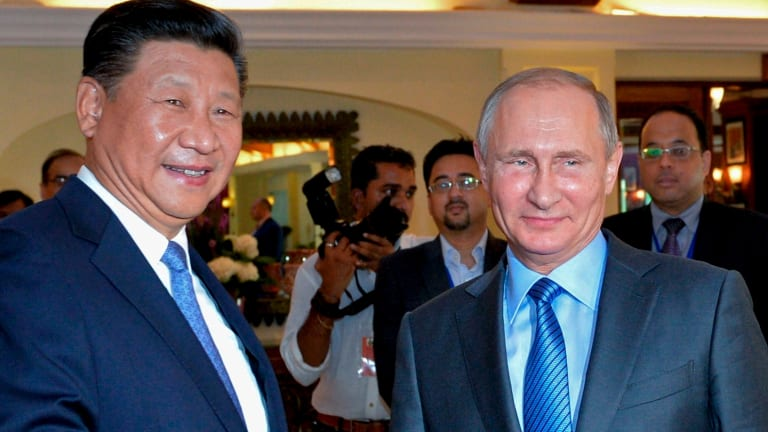 The summit will feature the likes of Russia's Vladimir Putin, right.