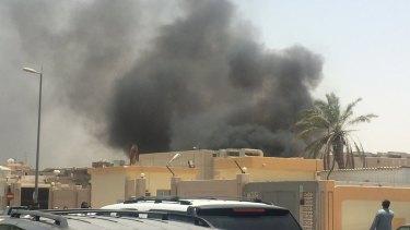 Second attack in a week: Smoke rises outside the Shiite mosque in Dammam, Saudi Arabia.