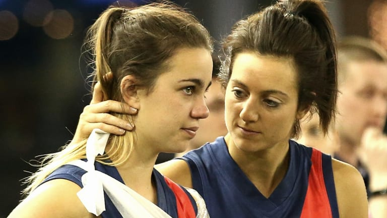 Heartache: an injured Chloe Molloy (left) is consoled by Steph Chiocci.