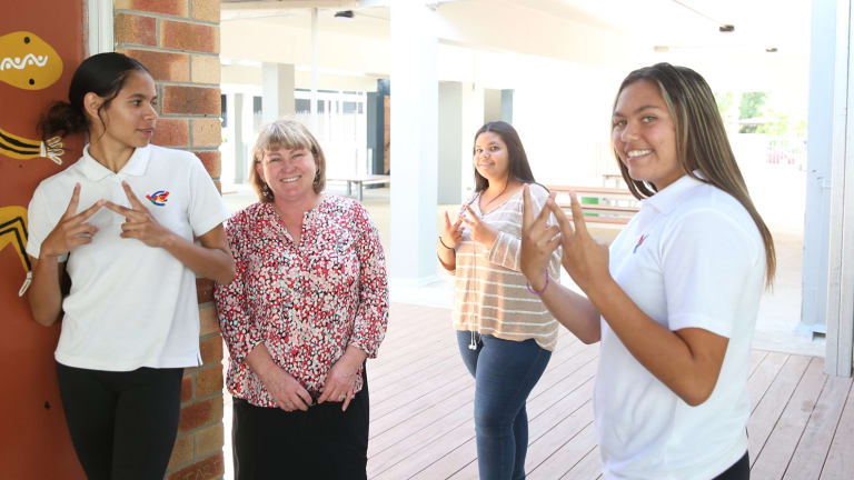 Walgett Community College executive principal Karen McKinnon with year 9 students.