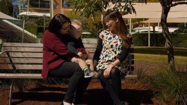 Amanda and Blake Darragh with paediatric radiation oncologist Jennifer Chard, in the gardens at the Children's Hospital at Westmead.