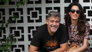 """How can one man be so lucky?"" says George Clooney, pictured here with UN lawyer, his wife Amal."