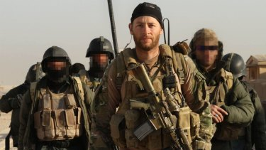 Tour of duty ... Geoff Evans on patrol with his unit in Afghanistan.