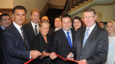 Millionaire property developer Harry Stamoulis (left) in 2014 with then planning minister Matthew Guy and then premier Denis Napthine (right) at the opening of the  Gods, Myths & Mortals exhibition at the Hellenic Museum in Melbourne.