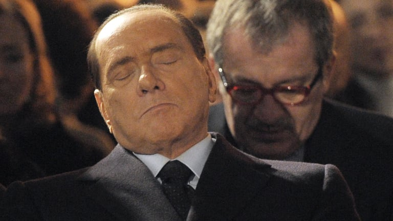 "Former Italian Premier Silvio Berlusconi, foreground, who praised Benito Mussolini for ""having done good""."