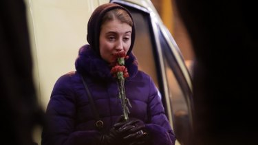 In mourning: Alexandra, a friend of Alexander Razumov, a member of the choir, cries.