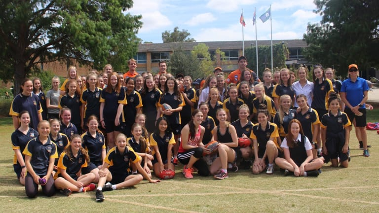 GWS Giants players ran clinics at Merici College as the school builds a team to play in AFL Canberra.