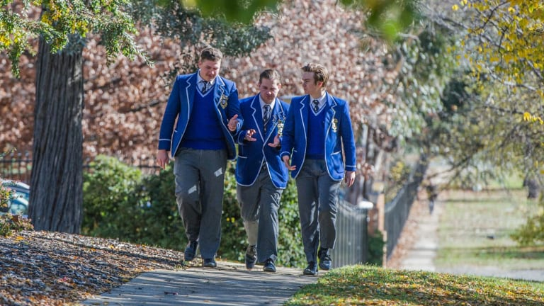 St Edmunds College student John-Paul Romano (centre) was suspending for trying to organise the student protest. His fellow Year 12 students Daniel Elix (left) and Jeremy Colbertaldo, say they supported John-Paul but were not suspended.