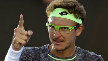 Zero to hero ... Uzbekistan's Denis Istomin celebrates after defeating Spain's Pablo Carreno Busta in the third round of the Australian Open.