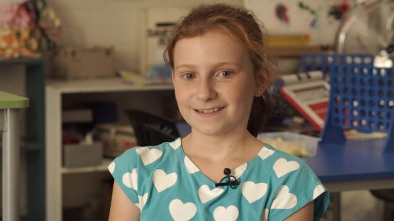 """Lottie, 10, has learned from her mother to think of happy things because """"it's not very healthy to worry too much""""."""