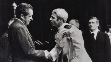 John McCain is greeted by President Richard Nixon in 1973.