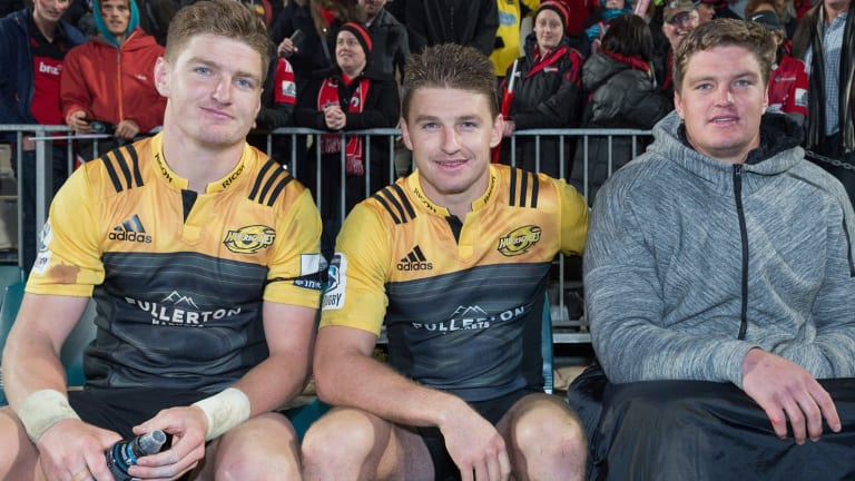 Three's company: Jordie and Beauden Barrett of the Hurricanes and Scott Barrett from the Crusaders.