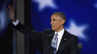 U.S. President Barack Obama waves while arriving on stage during the Democratic National Convention.