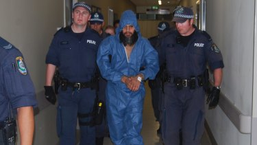Malcolm Naden escorted from Manning Base Hospital in Taree in March 2012.