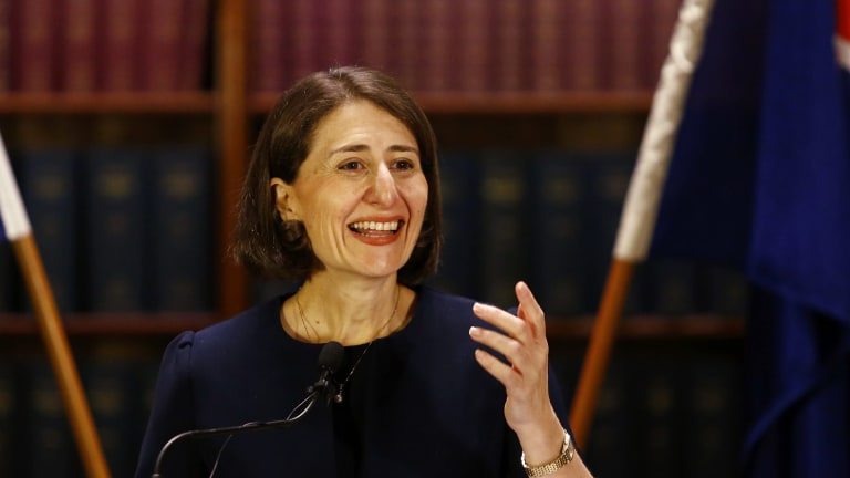 Gladys Berejiklian smiles at a press conference on Monday.