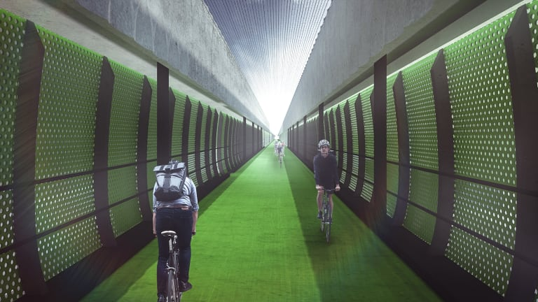 """An artist's impression of the express """"veloway"""" planned for above Footscray Road as part of the Western Distributor project."""