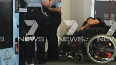 This image, sent to Seven News, purports to show Grant Hackett slumped over next to police at Melbourne Airport.
