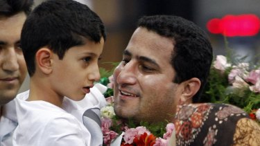 Shahram Amiri greets his son Amir Hossein after arriving back in Iran in July 2010.