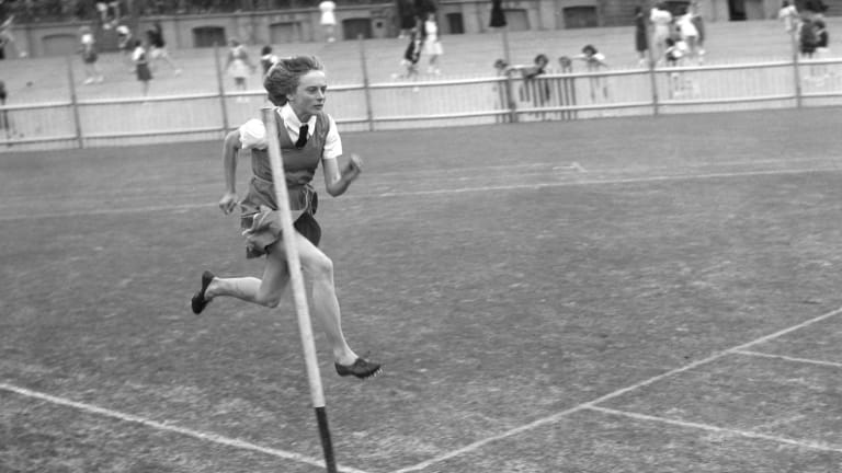 Child ctar: Betty Cuthbert, then 14, from Macarthur Girls High School, tries out the track at a schools athletics carnival in Sydney on July 16, 1952.