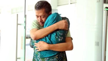 A still from the Indonesian government-backed video shows Heru Kurnia returning to Indonesia and his family.
