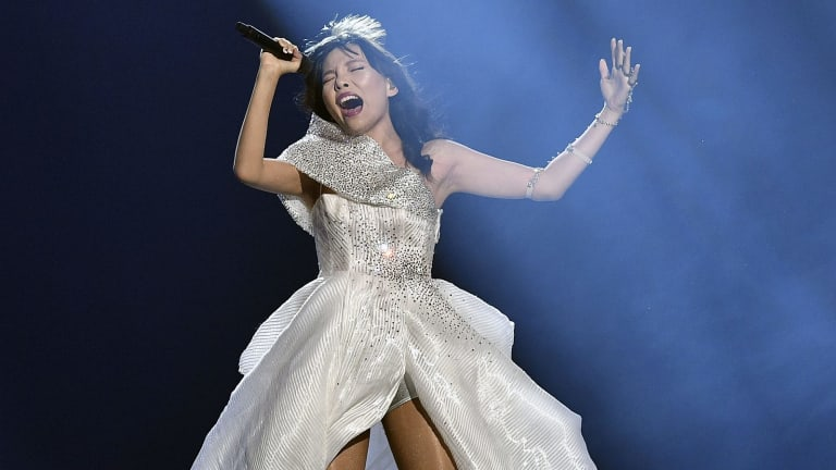 Australia's Dami Im performs the song Sound of Silence in her Steven Khalil gown.
