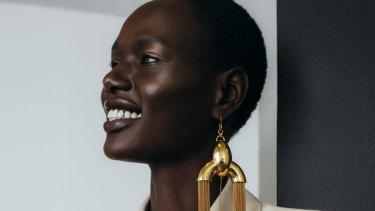 "Bianca Spender ""Blazer"" dress, $825. Ellery earrings, POA."