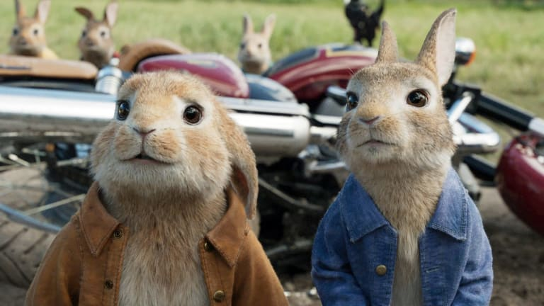 This image released by Columbia Pictures shows characters Benjamin, voiced by Colin Moody, left, and Peter Rabbit, voiced by James Corden and Cottontail in a scene from Peter Rabbit.