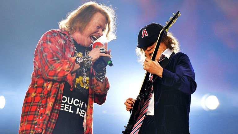 Singer Axl Rose, left and Angus Young of the band AC/DC perform at the Olympic Stadium in London, Saturday, June 4, 2016.