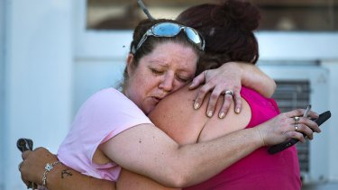 Two women embrace after the fatal shooting at the First Baptist Church in Sutherland Springs,Texas.