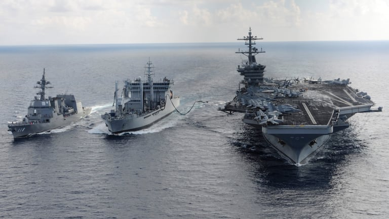 In this 2015 US Navy picture, the aircraft carrier USS Theodore Roosevelt and Japanese Maritime Self-defence Force Akizuki-class destroyer JS Fuyuzuki transit alongside the Indian Deepak-class fleet tanker INS Shakti during Exercise Malabar.