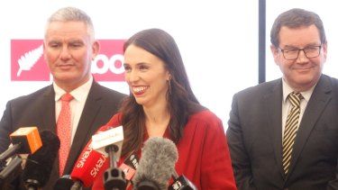 Labour leader Jacinda Ardern flanked by deputy leader Kelvin Davis (left) and Wellington Central MP Grant Robertson (right) during her announcement that Labour would form a government with NZ First.
