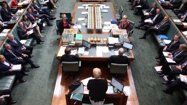Speaker Julie Bishop addresess the House as Acting Prime Minister Julie Bishop and Acting Opposition Leader Tanya Plibersek sit at the table during question time on December 3.