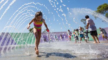 Families cooled off at Blaxland Riverside Park in Parramatta as the mercury topped 40 degrees.