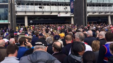The Grand Final day queue for tickets outside the MCG Members Stand.