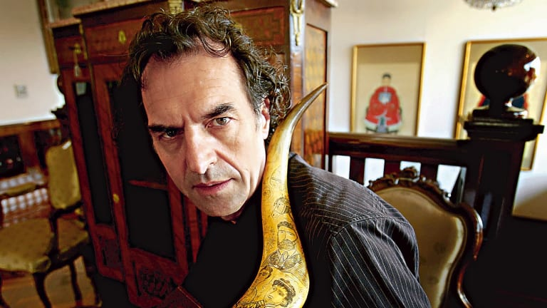 Tom Thompson, a collector of Ned Kelly memorabilia, in 2006 with a scrimshaw horns carved with Kelly gang imagery.