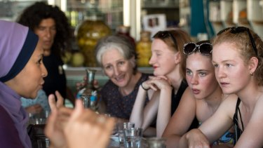 Cesca Falcini, 14 (with black and white sunglasses) and friend Alycia Eicke, 15, at the Moroccan Deli-cacy cafe in Brunswick taking part in Speed Date a Muslim, asking Muslim women about their faith and culture.