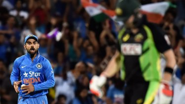 Pumped up: Virat Kohli celebrates the wicket of Steve Smith at Adelaide Oval.