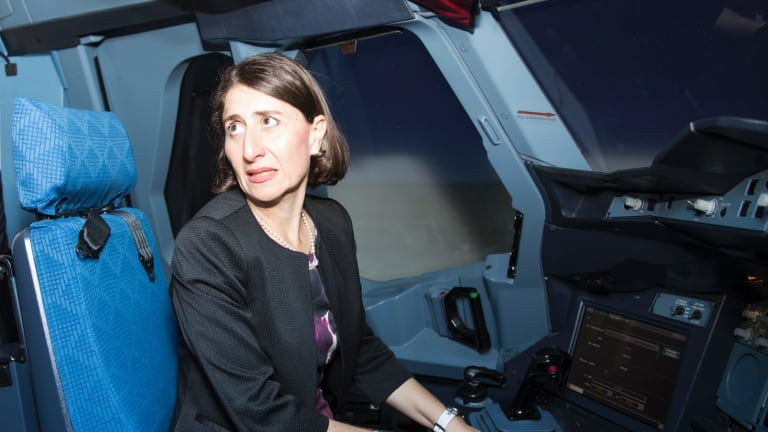 Premier Gladys Berejiklian tries a flight simulator at Incheon airport, Seoul.