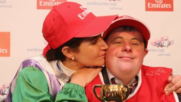 Michelle Payne celebrates her winning ride with brother and strapper Stephen Payne.