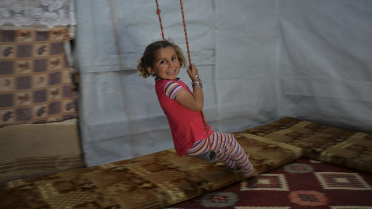 She might live in a refugee camp but like children everywhere, Reem, 4, still seizes every opportunity to play.