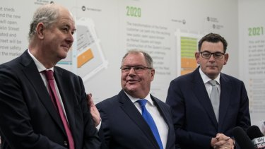 Lord Mayor Robert Doyle flanked by Planning Minister Richard Wynne (left) and Premier Daniel Andrews (right) at the market last month.